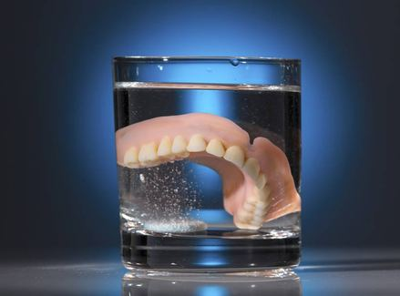 a denture in a glass of water