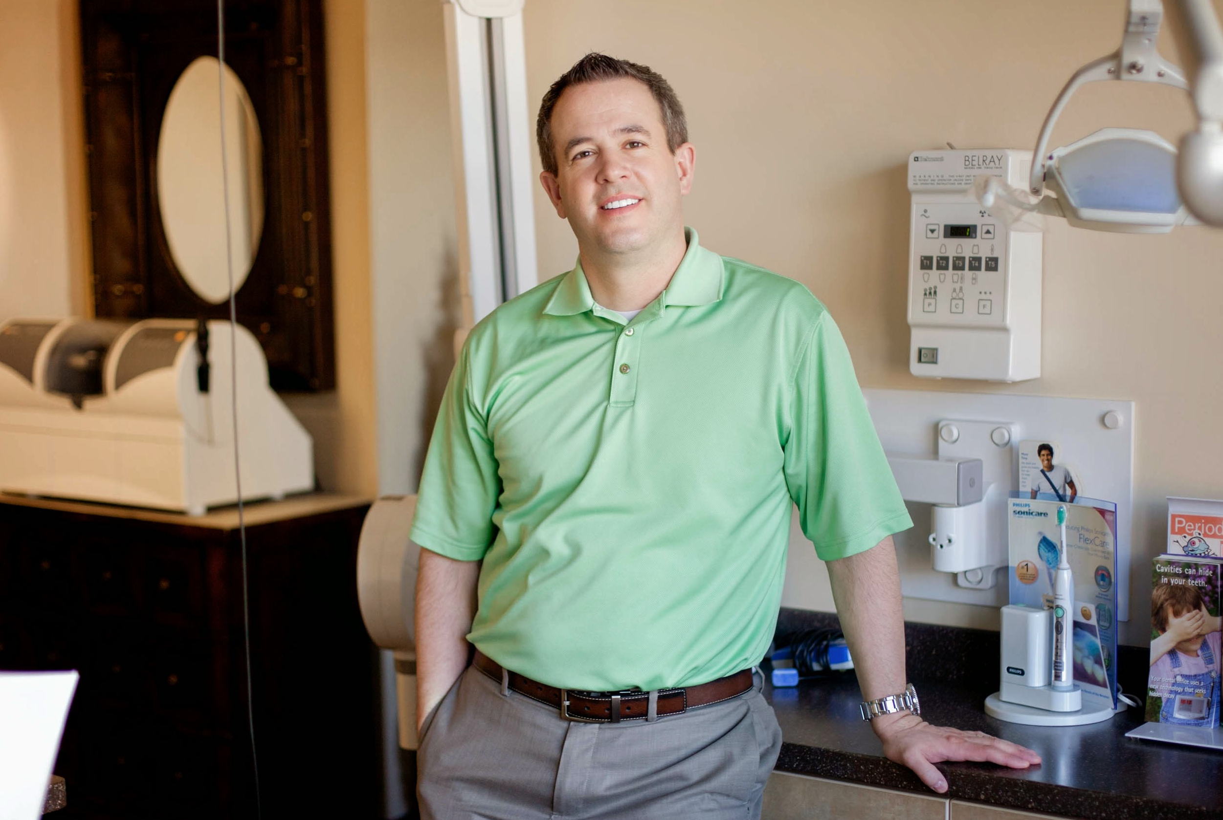 dentist standing in front of technology in office