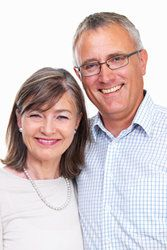Smiling middle-aged couple posing for picture