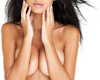 Topless woman with large breasts holding arms over nipples