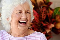 Laughing senior woman in striped shirt
