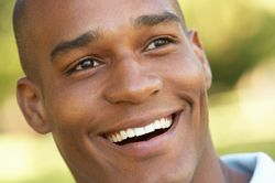 Close up of laughing man looking off into distance