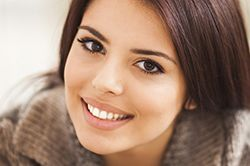 Smiling beautiful young woman with brown hair