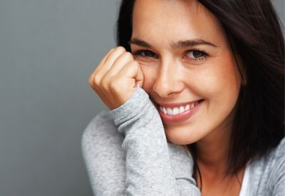 A dark-haired woman with a great smile