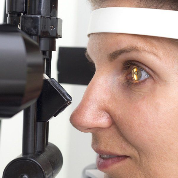 Photo of a woman receiving an eye exam