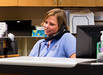 Our receptionist picks up patient's call with a smile.