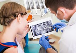 Dentist reviewing x-ray with patient