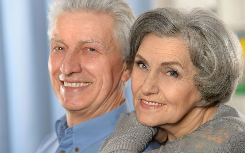 image of smiling couple with dental implants