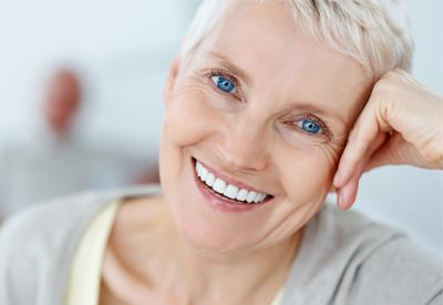 An older woman with a healthy and complete smile