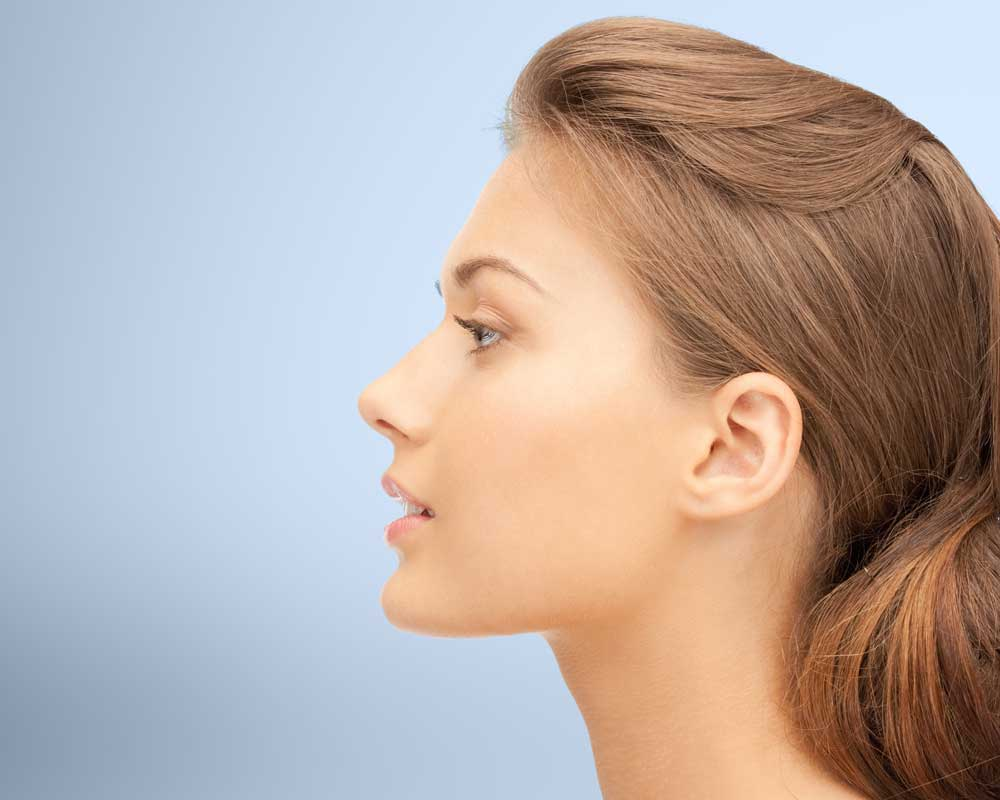 Profile of attractive woman staring to left of frame