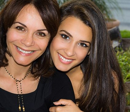A mother and daughter with beautiful smiles