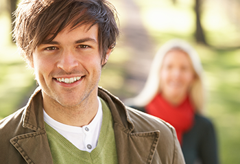 Young attractive couple smiling happy at the park