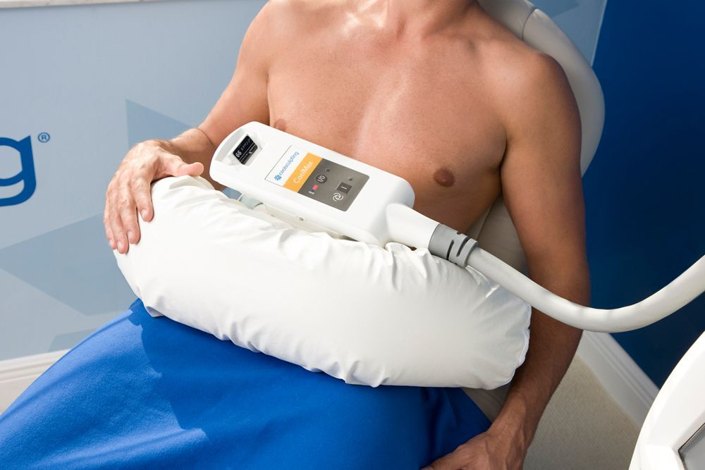 Patient undergoes CoolSculpting treatment.