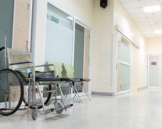 Empty hospital corridor with wheelchair