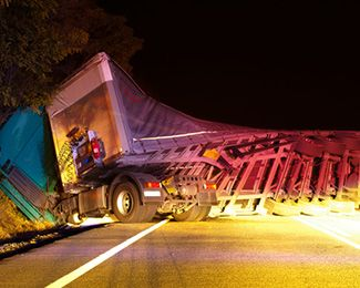 Twisted semi-truck trailer lying on road after accident