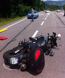 A motorcycle lies on the road after an accident