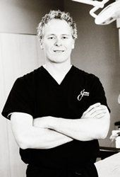 Portrait of plastic surgeon Dr. Justin Jones.