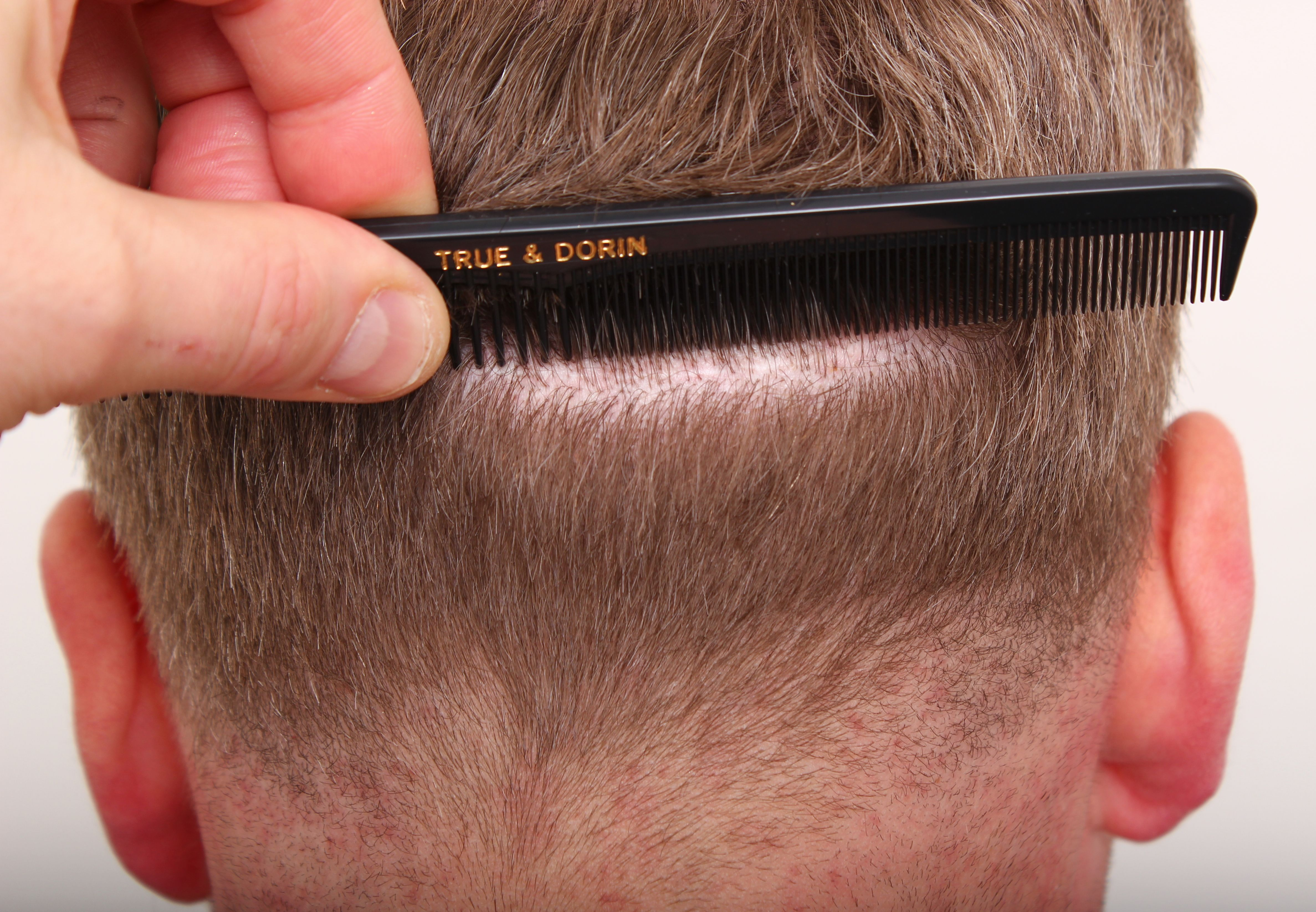 Close up of man parting hair