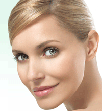 A beautiful blonde woman with her hair pulled back.