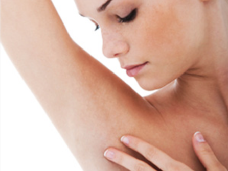 Picture of woman with her hand on her underarm.