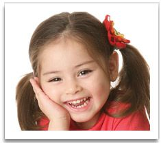 Smiling young girl in pigtails