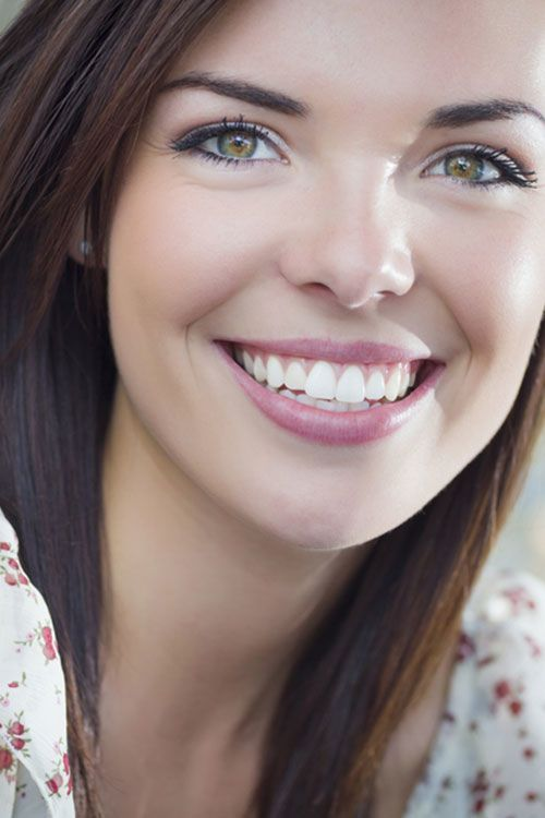 Smiling young woman with beautiful smile