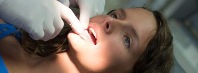 Woman undergoing an oral cancer screening.