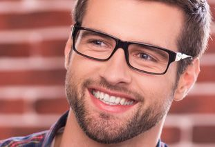 Young man with straight teeth and glasses