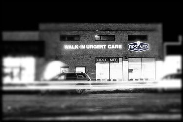 Black and white image of first med walk-in center at night