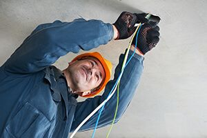 An electrician working with wires