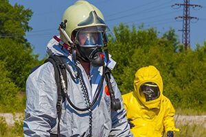 Two workers in HAZMAT suits