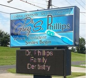 Exterior sign for the office of Dr. Greg S. Phillips