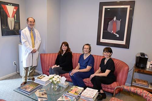 Dr. Jonathan Levy along with his dental staff