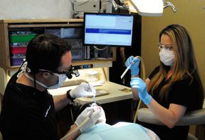 Dr. Peccora and his staff exam patient's oral health.