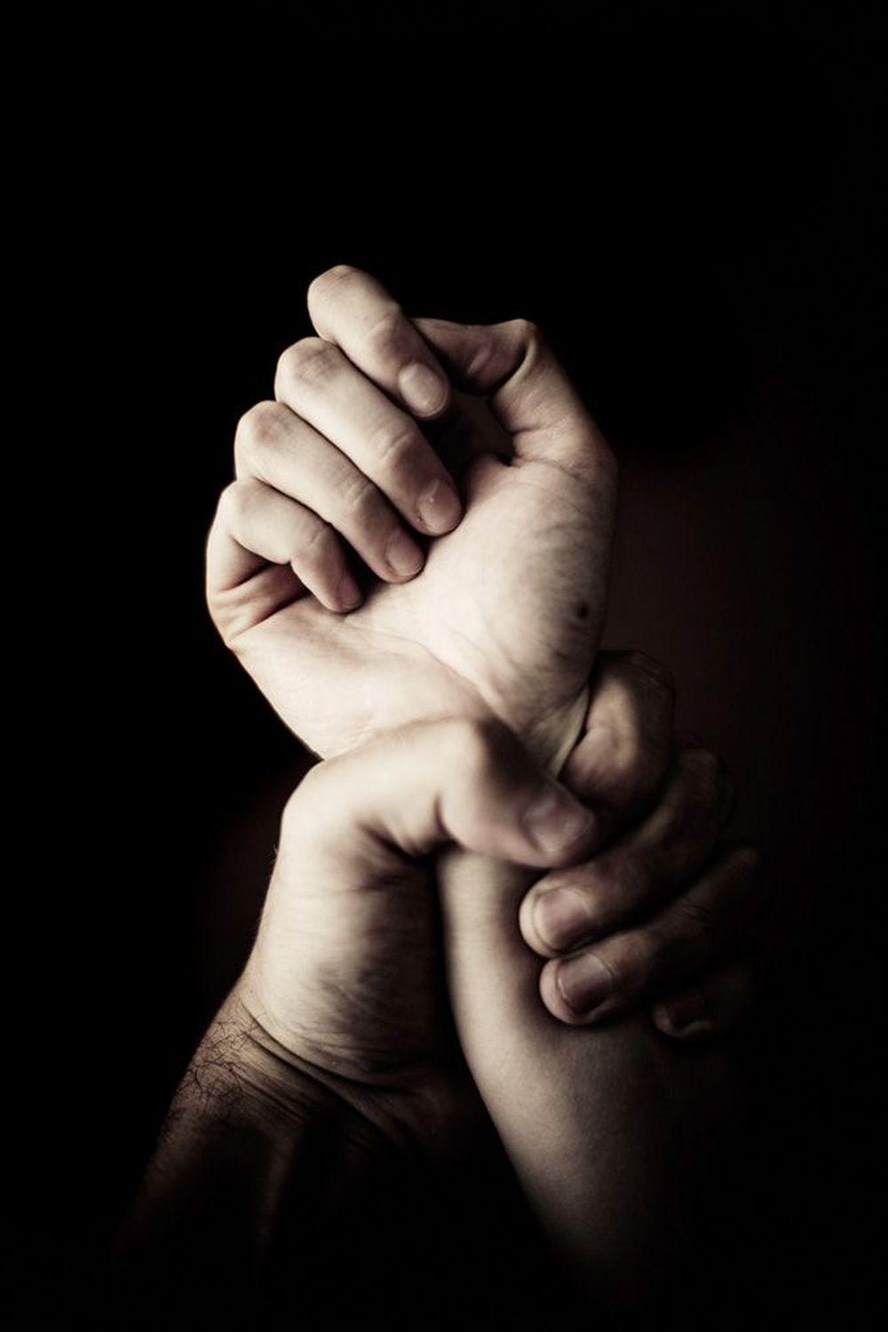 Hand closed around fist