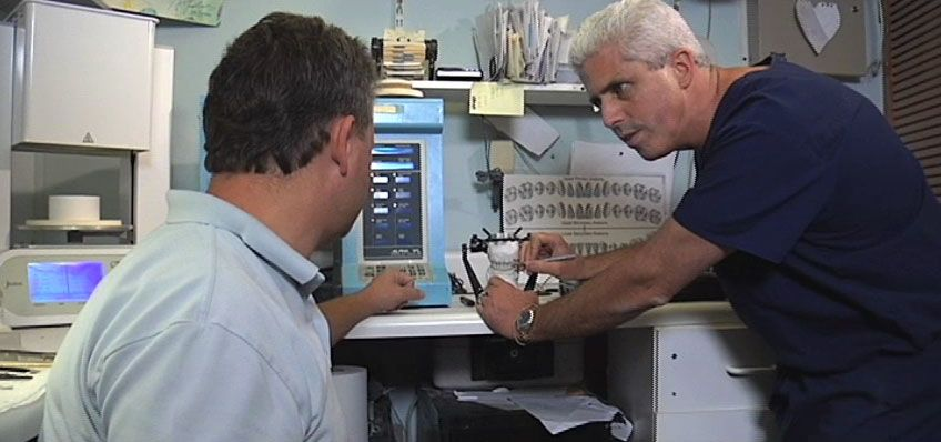 Dr. Mormino in his dental laboratory helping a patient