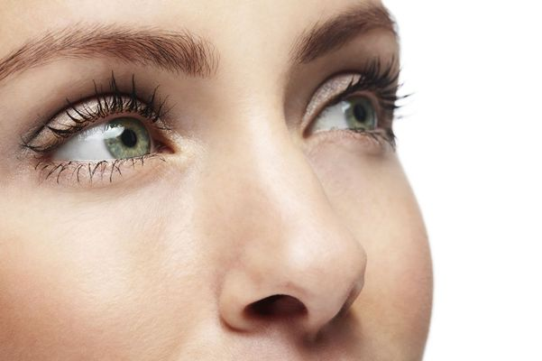 A woman with green eyes enjoys the effects of cosmetic injectables