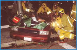 Firefighters at the scene of a car crash