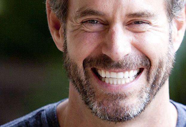 Smiling man showing bright white teeth
