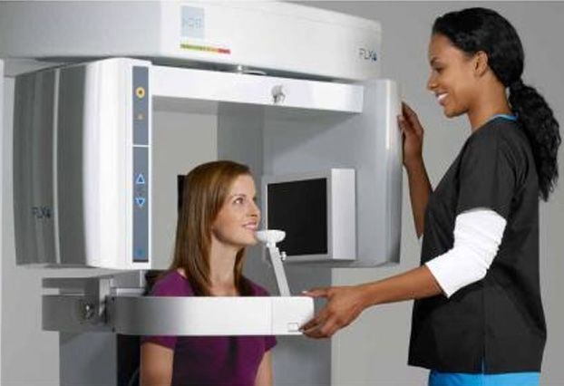 Woman having panoramic x-ray taken of her mouth