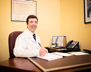 Dr. Samuel at his desk