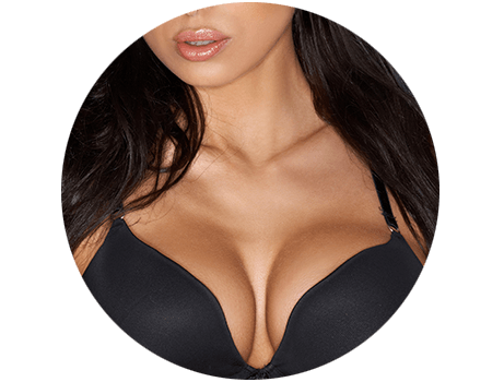 Close-up of a woman with large breasts in a black bra