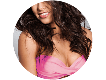 Curly haired woman with exposed cleavage