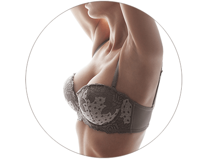 Woman in a bra with her hands up