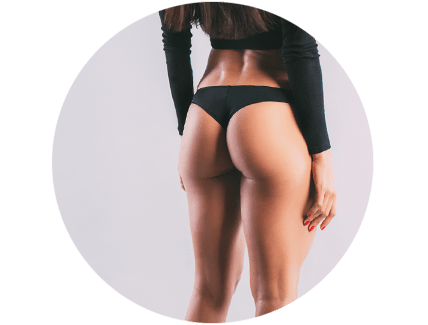 A woman in black underwear with a perky buttocks