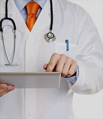 A doctor reading a chart