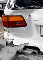 A car with a damaged rear bumper
