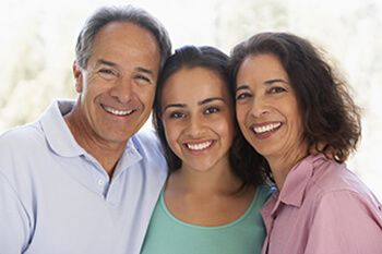 Parents smiling with their daughter