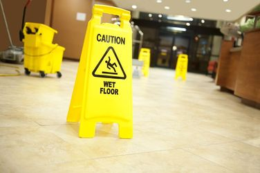 A wet floor sign warns patrons about potential slip-and-fall hazards