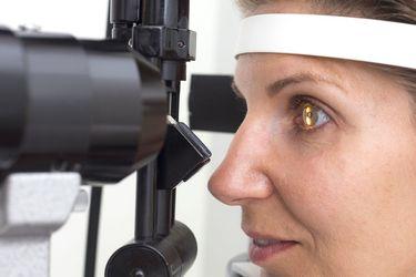 Woman undergoing comprehensive eye exam